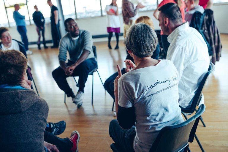 David Ellington leads a workshop, with participants sat in a circle.