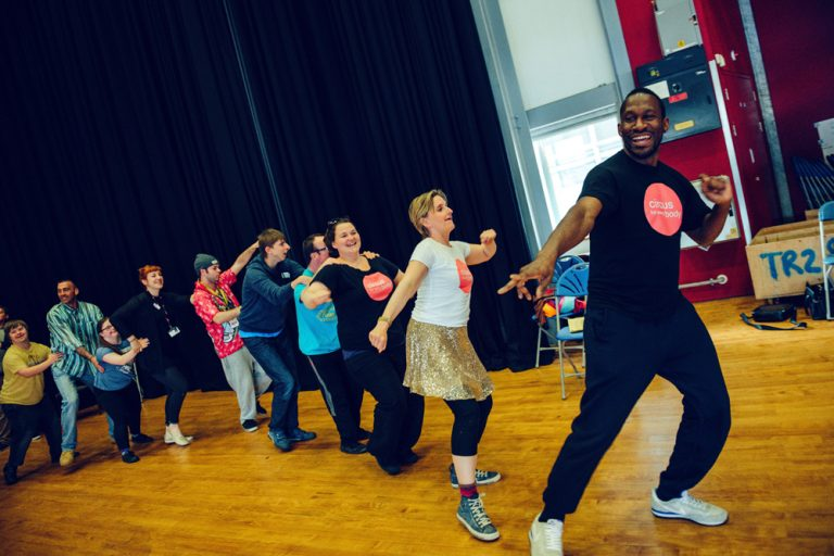 David Ellington and Claire Hodgson lead a conga line of workshop participants at the Plymouth Creative Explorations workshops.