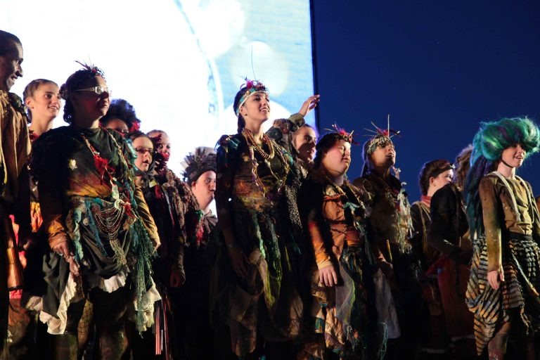 Performers on stage in costume for Breathe, London 2012 Olympics