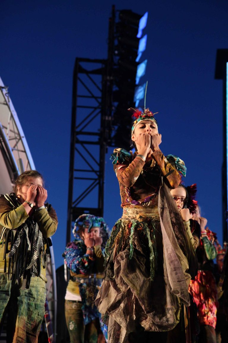 Performers on stage in costume for Breathe, London 2012 Olympics - performers are covering their faces