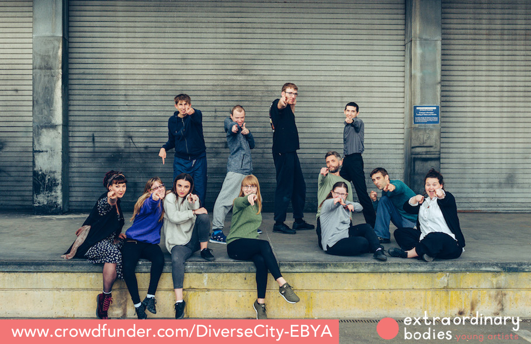 EBYA members sat down and standing, pointing to camera and smiling.