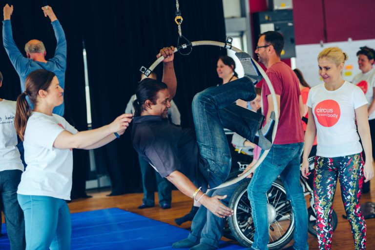 Participants of the Extraordinary Bodies Creative Explorations workshops learn circus skills in aerial hoop.