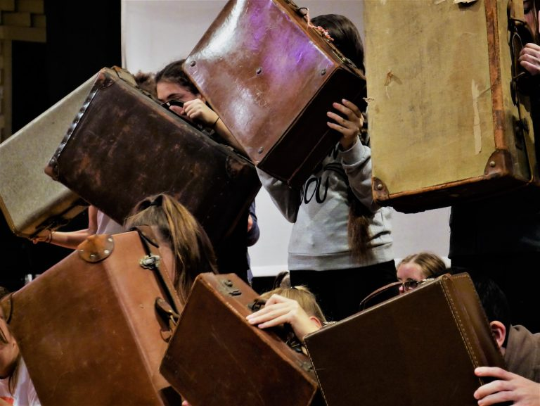 'A case for inclusivity' - performers hold up vintage suitcases to the audience