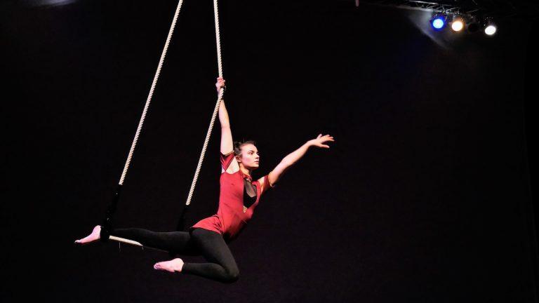 EBYA member Bec performs a trapeze solo.