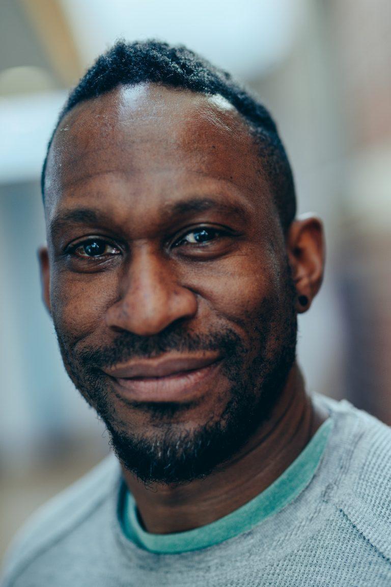 David smiling to camera.