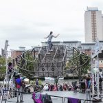 Extraordinary Bodies, What Am I Worth? performance shot from Sunderland 2018: As the structure spins, Aislinn is climbing and balancing a top the set.