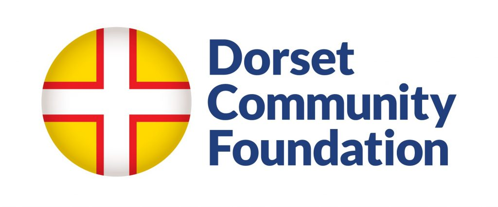 "Logo ""Dorset Community Foundation"" Text sits next to circular flag - white cross with red outline, on yellow background."